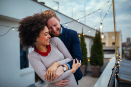 Happy Couple on Balcony - How to Date a Doctor