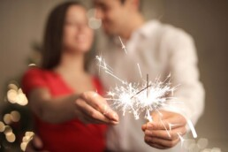 New Years Couple with Sparklers - Relationship Resolutions