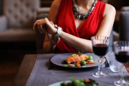 Woman Stares at Her Watch During Date - How to Handle Rejection Like a Boss