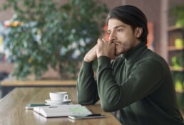 Man Stares Off in Distance - Breaking Up With Your Deal Breakers
