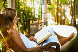 Woman Reads a Book Outside - False First Impressions