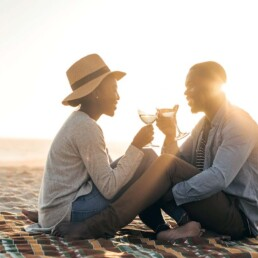 Couple Toasting on the Beach - Five Apology Styles