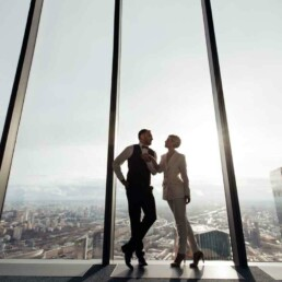 Couple Looks Out Over City - Make Time For a Relationship