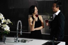 Couple discusses love and politics over red wine in the kitchen
